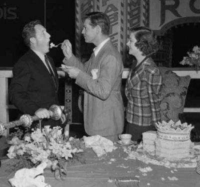 Sharing his 37th birthday cake with Spencer Tracy and Myrna Loy