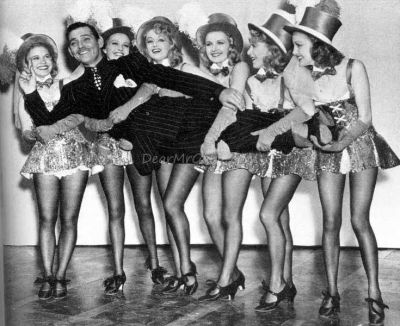 "Clark and the blondes in ""Idiot's Delight."" Virginia is the last one on the right...she got his feet!"